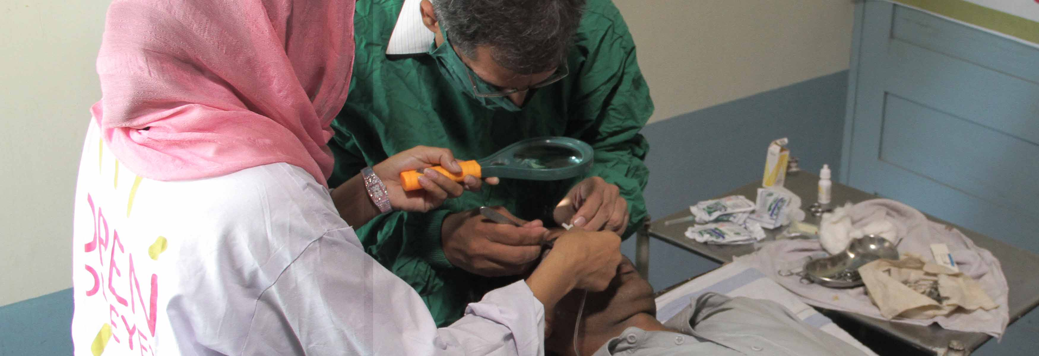 Eye specialist treating a patient